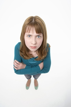 foreshortening: Angry-looking teenage Girl arms crossed elevated view
