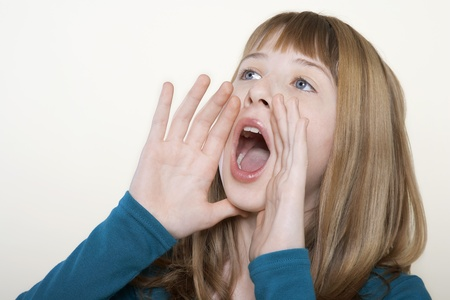 only teenage girls: Teenage girl hands cuffed around mouth shouting close-up
