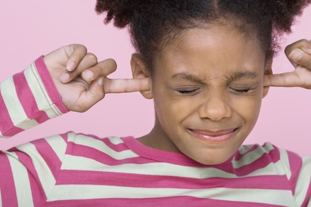 Girl with eyes closed putting Fingers in Ears close-up Stock Photo - 12514185
