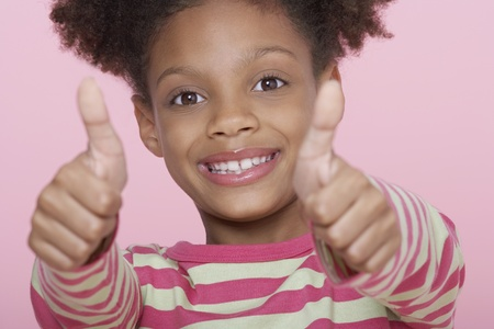 Young Girl smiling Giving Thumbs Up Stock Photo - 12514186