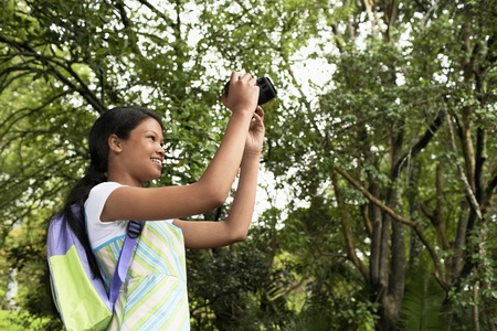 Girl Photographing in Forest Stock Photo - 12514219