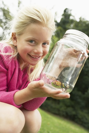 Girl Showing Insect in Jar Stock Photo - 12514220