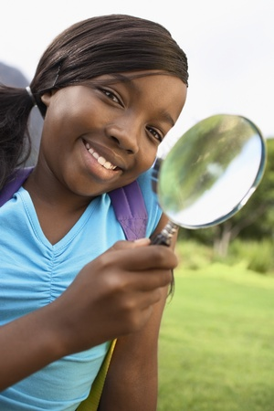Girl Using Magnifying Glass Stock Photo