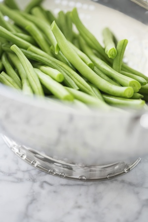 Metal bowl of green beans Stock Photo - 12514241