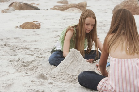 children sandcastle: Two Girls Playing on Beach