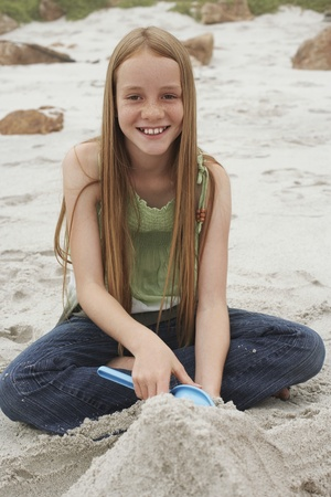 Girl Playing on Beach Stock Photo - 12514265