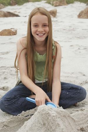 Girl Playing on Beach Stock Photo - 12514265