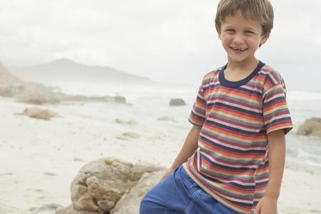 half length posed: Smiling Boy on Beach