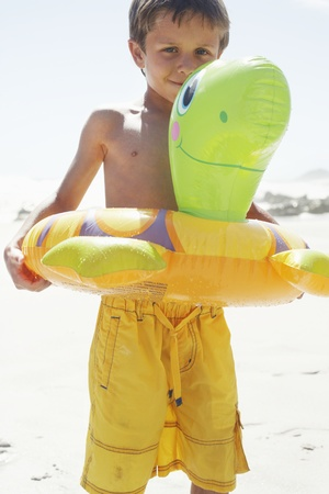 float tube: Boy Playing With Float Tube on Beach