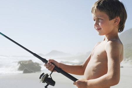 partially nude: Boy Fishing on Beach
