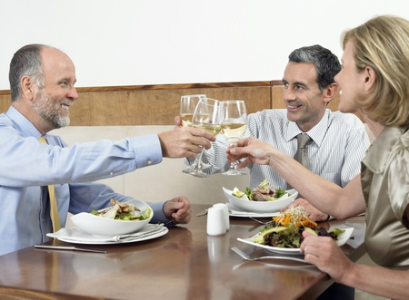 Businesspeople toasting drinks in restaurant Stock Photo - 12547792