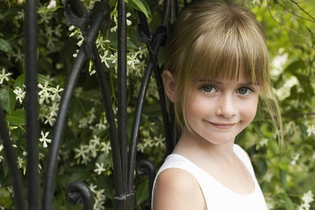 Young girl leaning on fence smiling portrait Stock Photo - 12547800