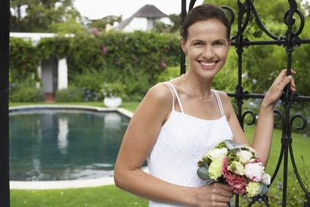 Happy Bride in Garden Stock Photo - 12547811