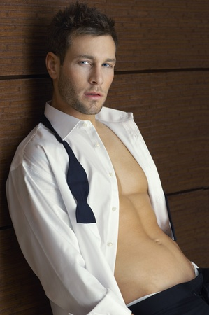 shirt unbuttoned: Man wearing tuxedo indoors portrait LANG_EVOIMAGES