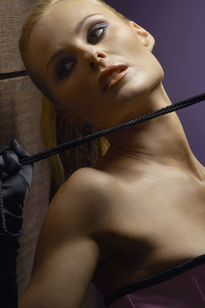 eroticism: Woman holding whip close-up portrait