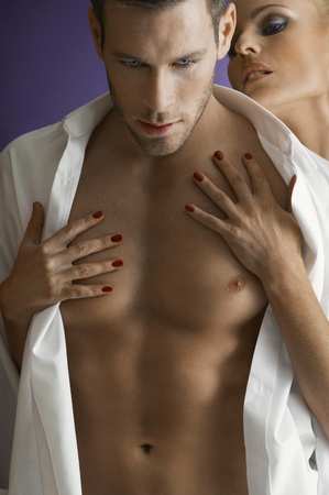 shirt unbuttoned: Woman embracing man close-up portrait LANG_EVOIMAGES