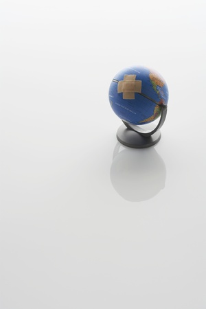 Globe With Bandaid Stock Photo - 12547856