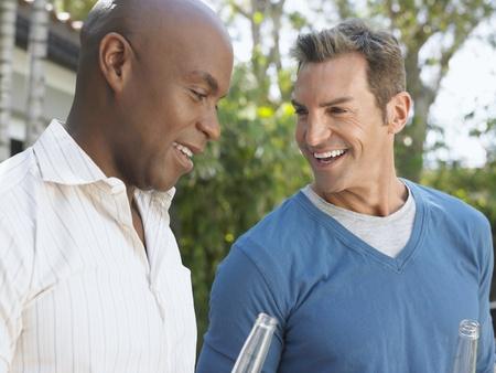 Two men having conversation outdoors Stock Photo - 12547860