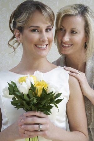 Young woman holding bouquet mother standing by Stock Photo - 12547927