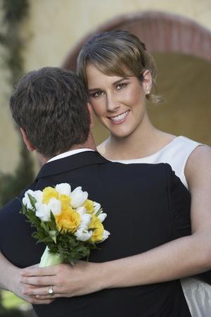 facing the camera: Bride (facing camera) and groom dancing