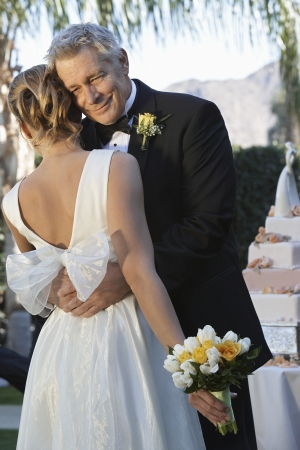 Father (facing camera) and bride dancing