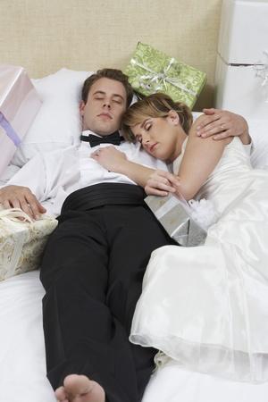 Bride and groom sleeping among presents Stock Photo - 12547980