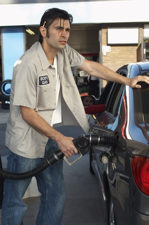 Service attendant pumping gas Stock Photo - 12547988