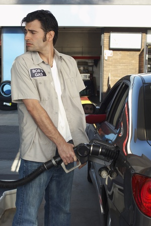 Service attendant pumping gas Stock Photo - 12547989