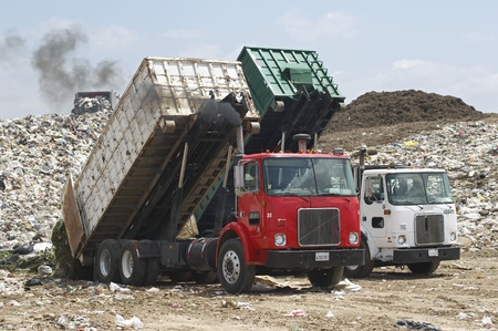 dumping: Trucks dumping waste at landfill site