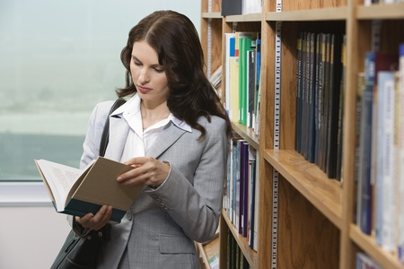 Woman reading in library Stock Photo - 12548011