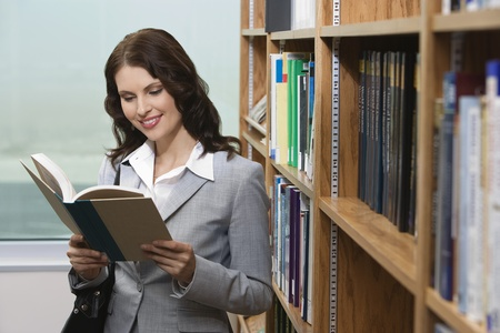 Woman reading in library Stock Photo - 12548012