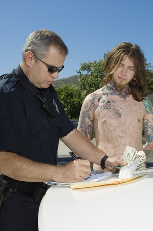 Officer Making a Drug Bust Stock Photo - 12548031