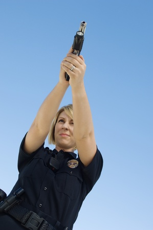 Police Officer Aiming Pistol Stock Photo - 12548045
