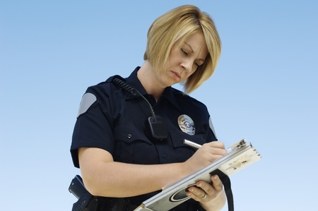 enforcing the law: Police Officer Writing Ticket