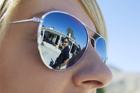 enforcing the law: Police Officer Reflected in Sunglasses