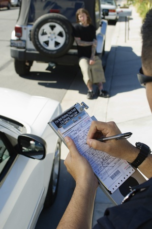 traffic ticket: Police Officer Writing Ticket