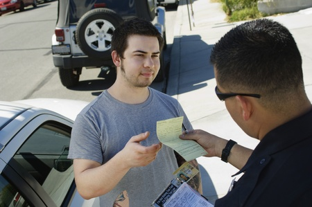 30 to 35 year olds: Police Officer Writing Ticket
