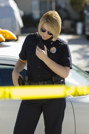 enforcing: Police Officer Using Two-Way Radio