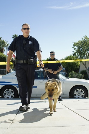 police tape: Police Officer and Police Dog LANG_EVOIMAGES