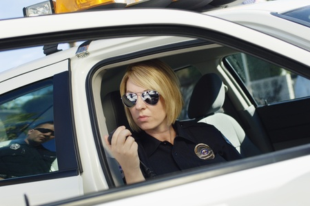 Police Officer Using Two-Way Radio Stock Photo - 12548065