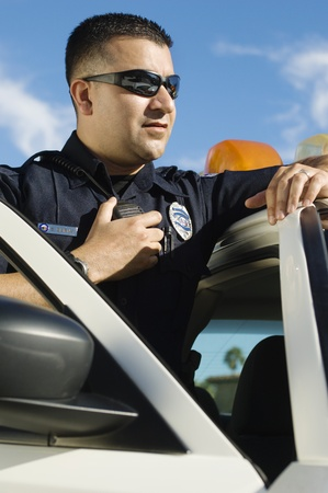 Police Officer Using Two-Way Radio Stock Photo - 12548069