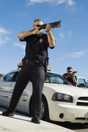 enforcing: Police Officer Aiming Shotgun