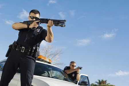 40 to 45 years old: Police Officer Aiming Shotgun