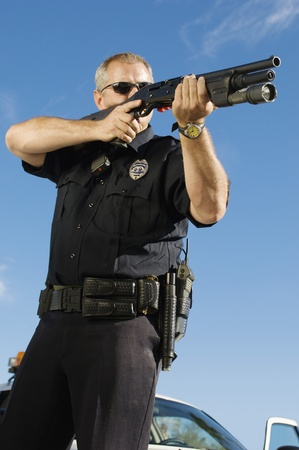45 gun: Police Officer Aiming Shotgun
