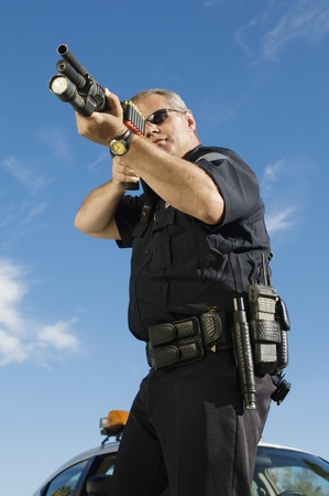 early 40s: Police Officer Aiming Shotgun