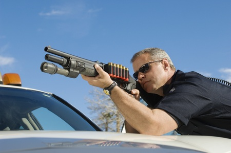 late forties: Police Officer Aiming Shotgun