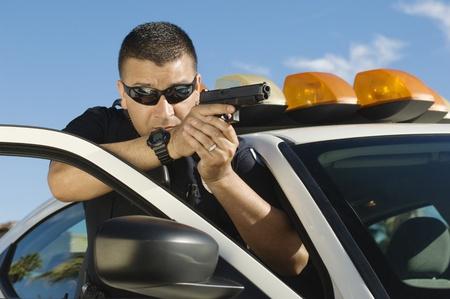motor officer: Police Officer Aiming Handgun