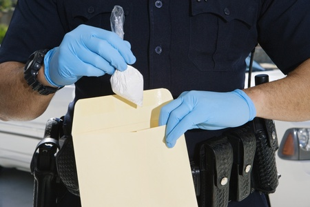 Police Officer Putting Cocaine in Evidence Envelope Stock Photo - 12548098