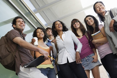 further education: Students smiling in hallway at school low angle view LANG_EVOIMAGES