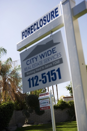 political and social issues: Real Estate Signs at Foreclosed Property